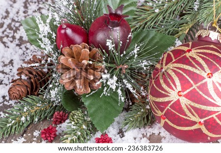 Closeup of Christmas decorations with evergreen tree branch - stock photo