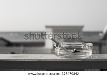 Closeup of cigarette on ashtray