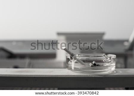 Closeup of cigarette on ashtray - stock photo