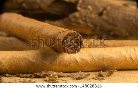 Closeup  of cigars rolled with loose tobacco leaves - stock photo