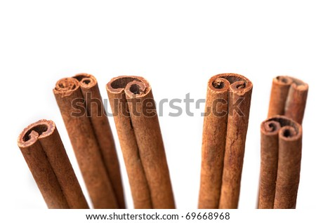 Closeup of cinnamon sticks isolated on white