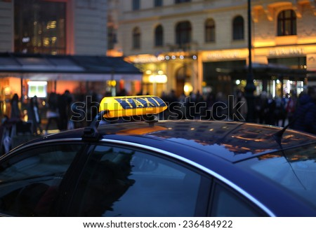 Closeup of city Taxi sign at night  - stock photo