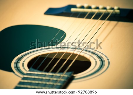 closeup of classic guitar with shallow depth of field - stock photo