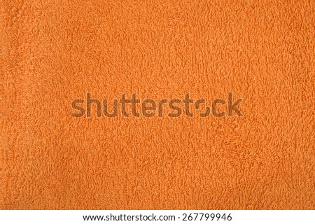 Closeup of cloth material terry towelling as used for pool towels, orange, texture, material - stock photo