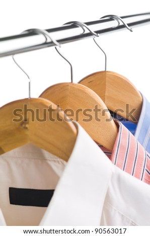 closeup of clothes hanger with shirts on white - stock photo