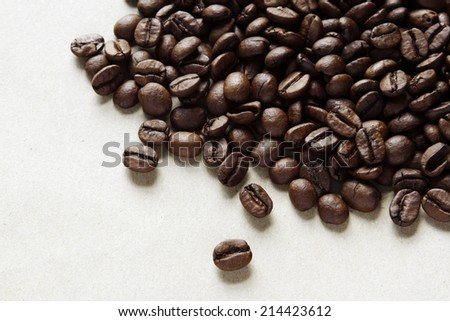 Closeup of coffee beans on plain background - stock photo