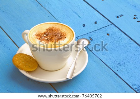 closeup of coffee with milk in white cup and a cookie - stock photo