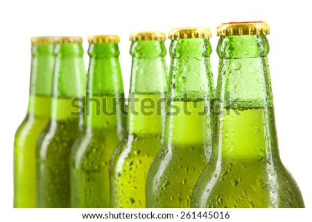 Closeup of cold drink in the bottles with green color, isolated over white background - stock photo