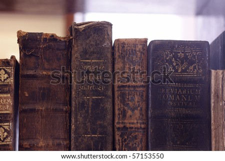 Closeup of colorful antique book backs. - stock photo