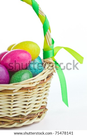 closeup of colorful easter eggs in basket - stock photo
