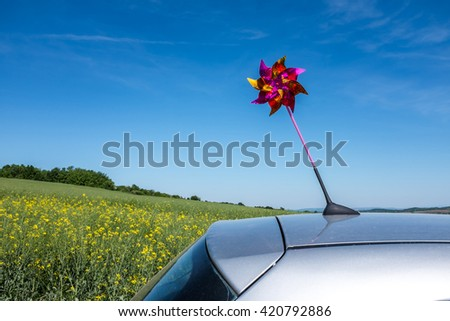 Closeup of colorful kite on car roof