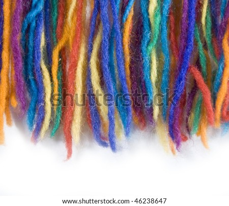 Closeup of colorful pieces of yarn isolated on white - stock photo