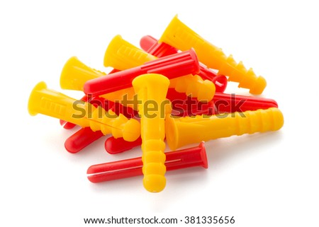 Closeup of colorful plastic dowels isolated on white background.