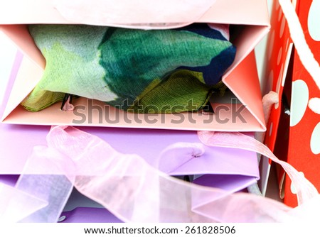 Closeup of colorful shopping bags tops abstract background - stock photo