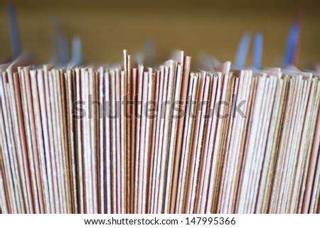 Closeup of colour coded filing system for folders - stock photo