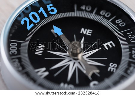 Closeup of compass showing new year 2015 direction - stock photo