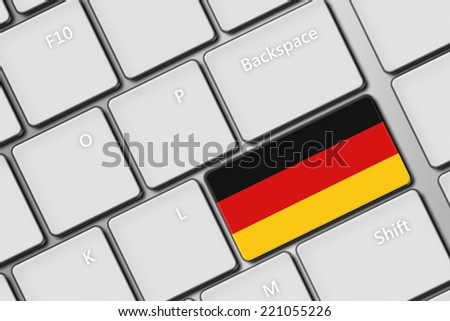 closeup of computer keyboard with german flag button - stock photo