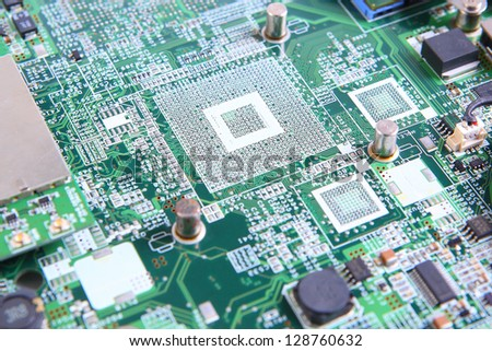Closeup of computer micro circuit board - stock photo
