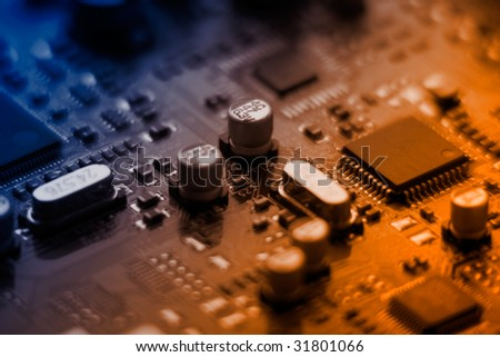 Closeup of computer plate with microchips colorized - stock photo