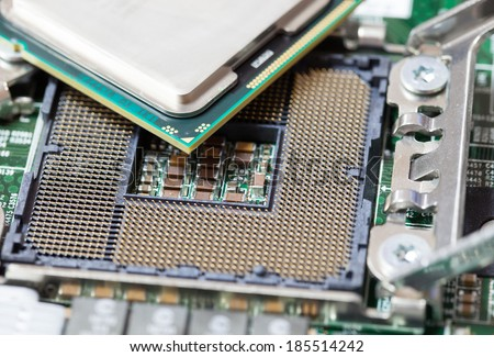 Closeup of Computer Processing Unit Socket on Mainboard Circuit. - stock photo