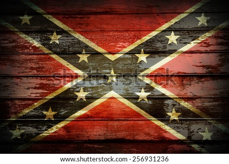 Closeup of Confederate flag on boards - stock photo