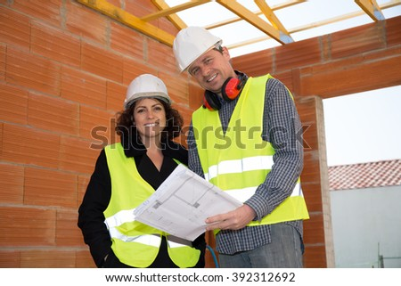 Closeup of construction people with white security helmet - stock photo