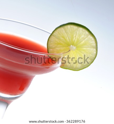 Closeup of Cosmopolitan cocktail in martini glass. Vodka, cranberry juice, triple sec liqueur, lime juice, garnished with lime  - stock photo