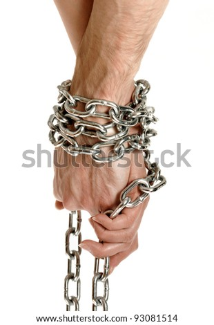 Closeup of couple hands tied together with a chain conceptual photo isolated on white background - stock photo