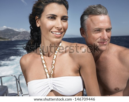 Closeup of couple looking away on yacht