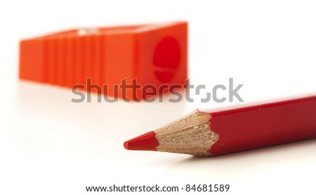 closeup of crayon and sharpener on white background - stock photo