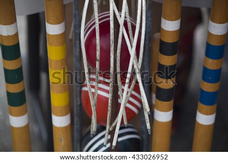 Closeup of croquet mallets and balls. - stock photo