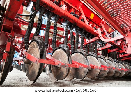 Closeup of cultivator knives of plowing tractor