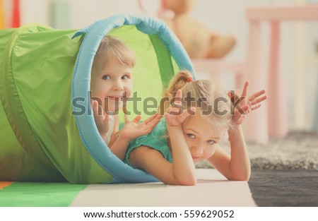 Closeup of cute little girls playing at home