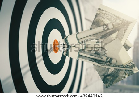 Closeup of dartboard with dollar banknote darts. Concept of targeting. 3D Rendering - stock photo