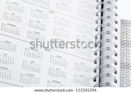 Closeup of dates in diary - stock photo
