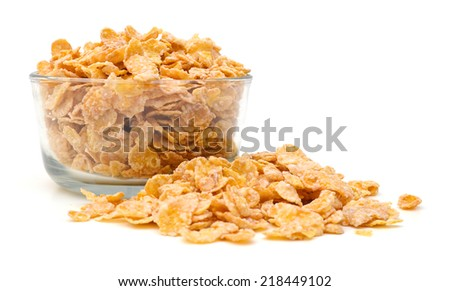 closeup of delicious cereals in glass bowl on a white background