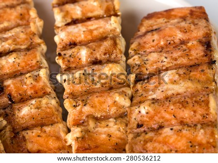 Closeup of delicious grilled salmon fillet. Macro. Can be used as a whole background.
