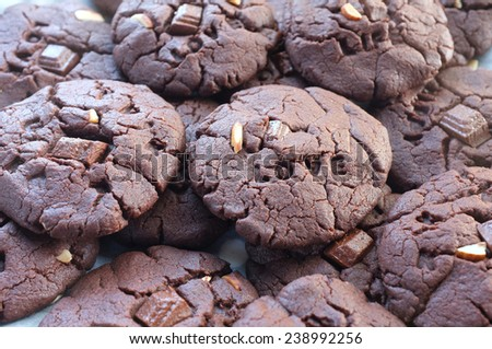 Closeup of delicious homemade chocolate chip cookies with text Love on cookie - stock photo
