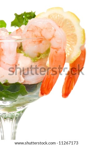 Closeup of delicious Prawn Cocktail.  Fresh jumbo shrimps, cream, lettuce leaves, lemon wedge and zesty sauce. Appetizer served in cocktail glass. - stock photo