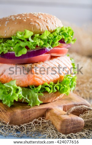 Closeup of delicious sandwich with big fish and vegetables