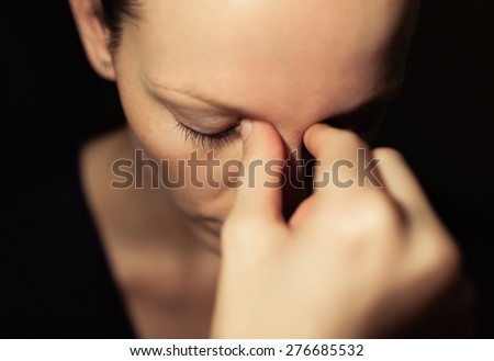 Closeup of depressed woman. - stock photo