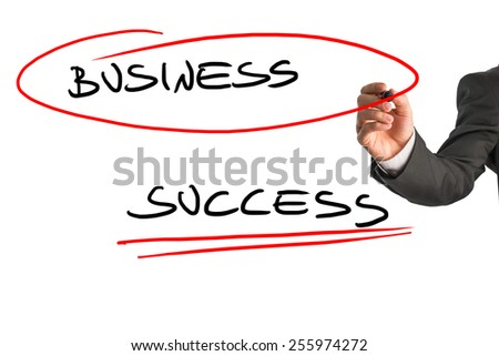 Closeup of determined businessman writing business success on white virtual screen. - stock photo