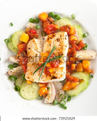 Closeup of Dinner Plate with Grilled White Fish and Vegetables - stock photo