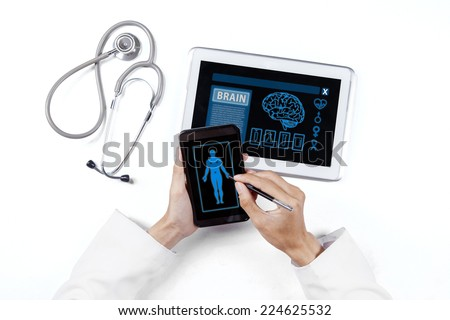 Closeup of doctor hands doing research of human with smartphone and tablet - stock photo