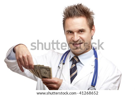 Closeup of doctor holding us dollar bills in his hands and count them. Isolated on white. - stock photo