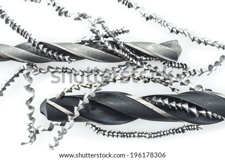 Closeup of drills and metal shavings on white background - stock photo