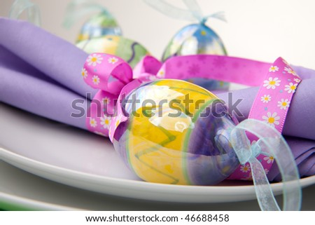 Closeup of Easter table setting with easter eggs