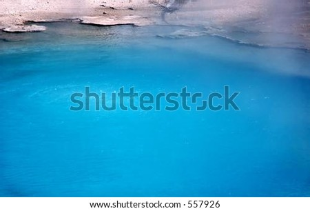 Closeup of edge of hot spring in Yellowstone National Park, Wyoming - stock photo