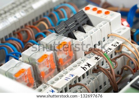 Closeup of electrical supplies in switchgear cabinet - stock photo