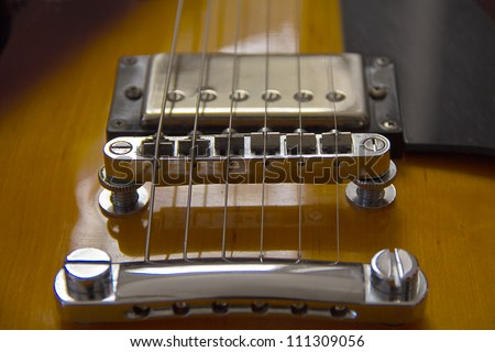 Closeup of electro-guitar bridge - stock photo